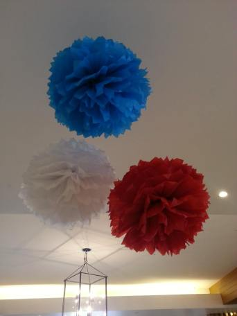 Red, blue and white pom poms