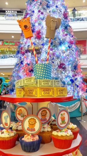 Circus animals and carnival tickets as cupcake tower topper