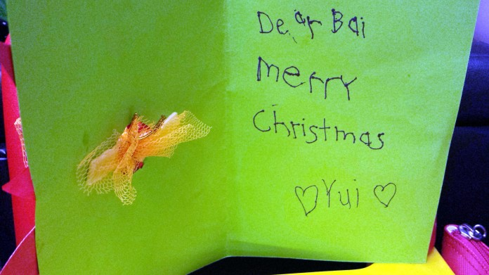 Step 10: Write a Christmas message inside the card. Yui wrote hers for her grandma